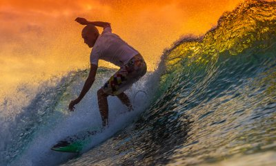 Surfing holidays are a popular type of travel.